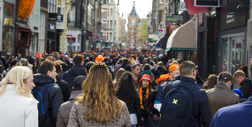 The streets of Amsterdam are packed with people celebrating the King's Birthday