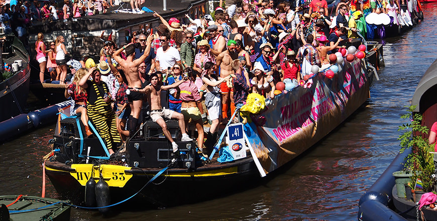 King's Day boats line the canals of Amsterdam
